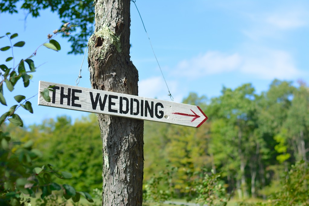 Signs such as this one lead the way to the wooded ceremony site...