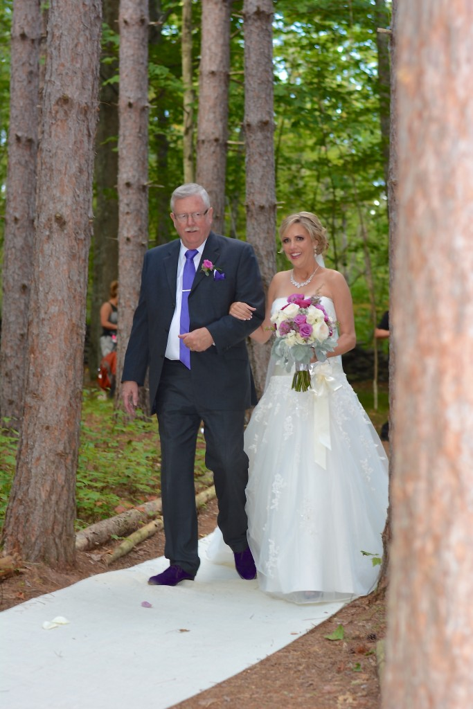 Beautiful Reagan making her walk down the aisle with her father...