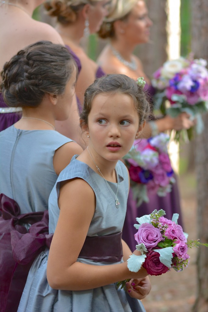 Reagan's sweet niece glancing back to see if her aunt was beginning her walk down the aisle...