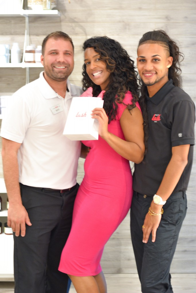 Owner of Lash Studio (far left) alongside one of his technicians (far right) and the lucky raffle winner who receives a free set of lashes!